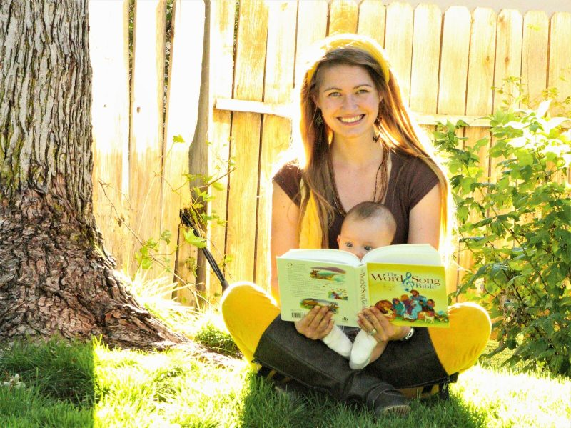woman-reading-to-infant